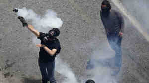 Earlier today (June 28, 2011) in Athens, a demonstrator threw a tear gas grenade back toward police.