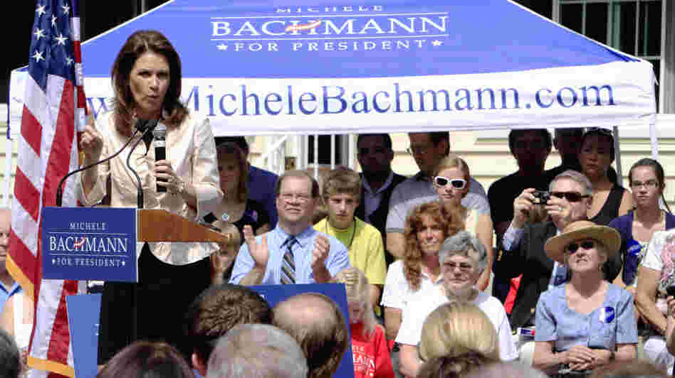 Republican presidential candidate  Michele Bachmann talks with supporters during a campaign stop in Raymond, N.H., on  Tuesday.