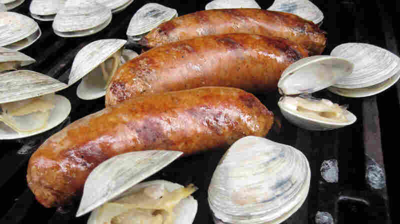 Chorizo and clams cooking on a grill
