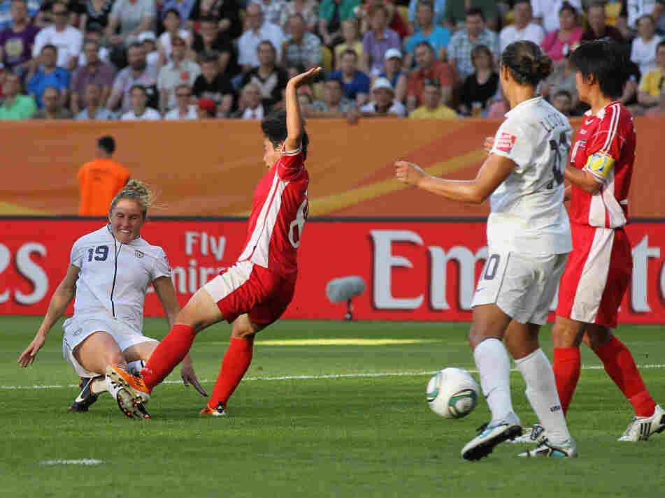 Rachel Buehler of the U.S., left, scores her team's second goal during the FIFA Women's World Cup Group C match between USA and Korea at Rudolf-Harbig-Stadion in Dresden, Germany.