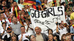 Soccer fans attend the women's World Cup opener between Germany and Canada. In Germany, the game drew a TV audience of more than 18 million, or a quarter of the country's population — better stats than some men's matches garner.
