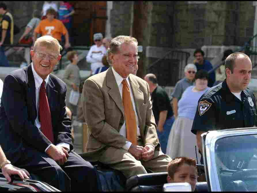 Famed college football coach Lou Holtz and TV personality Regis Philbin, serving as grand marshals of Steubenville, Ohio's Dean Martin Day Parade. What do they have in common? Holtz coached football at Notre Dame for 10 seasons — the same school where Philbin received his bachelors degree.