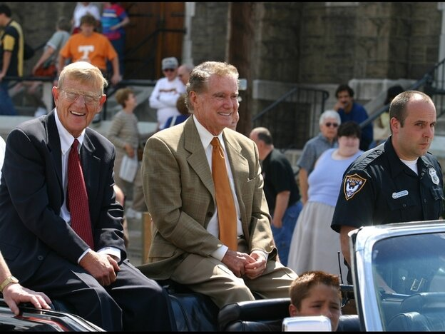 Famed college football coach Lou Holtz and TV personality Regis Philbin, serving as grand marshals of Steubenville, Ohio's Dean Martin Day Parade. What do they have in common? Holtz coached football at Notre Dame for 10 seasons — the same school where