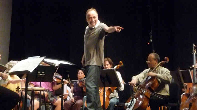 Conductor George Manahan recognizes a composer at the rehearsal for the Jazz Composers Orchestra Institute reading.