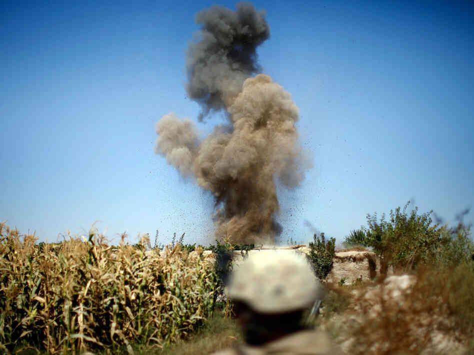 Marines detonate a homemade explosive device in the Helmand River valley in Afghanistan in 2009.