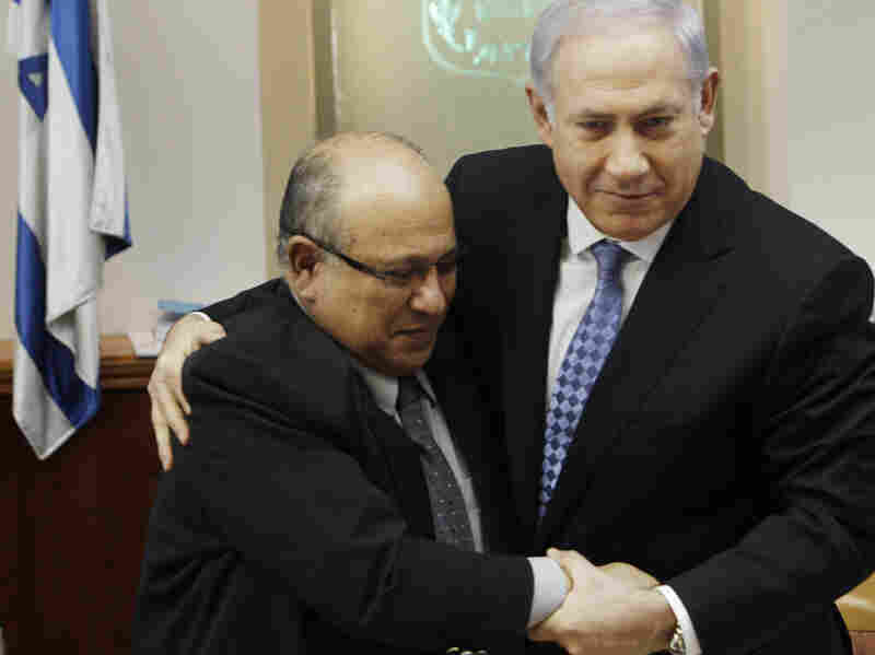 Israeli Prime Minister Benjamin Netanyahu hugs outgoing Mossad chief Meir Dagan after thanking him at the beginning of a Cabinet meeting in Jerusalem on Jan. 2.