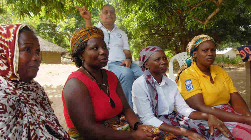 Cassimo Bique, an OB-GYN, sits with traditional birth attendants in Mozambique. Bique is an advocate for the drug misoprostol, which can prevent postpartum hemorrhaging in women.
