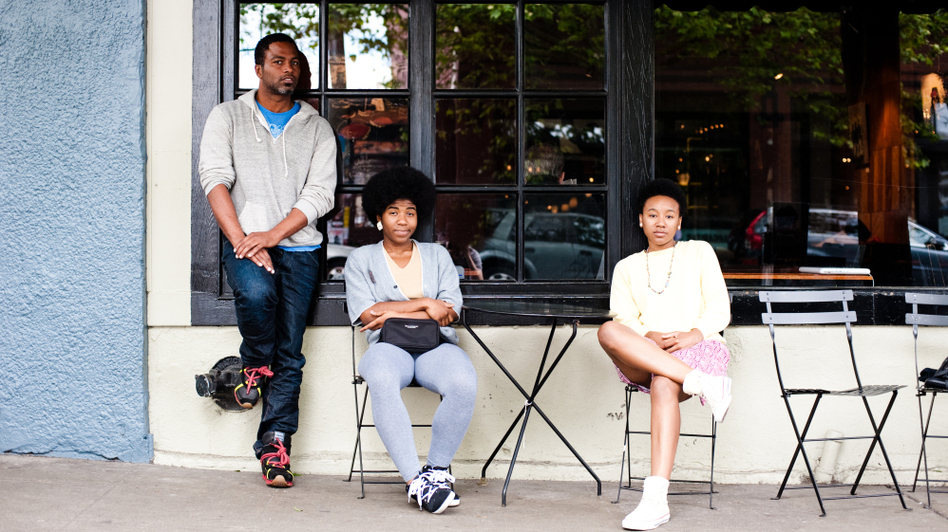 Shabazz Palaces and THEESatisfaction (from left to right, Ishmael Butler, Catherine Harris-White and Stasia Irons) outside Caffe Vita in Capitol Hill. (Kyle Johnson for NPR)