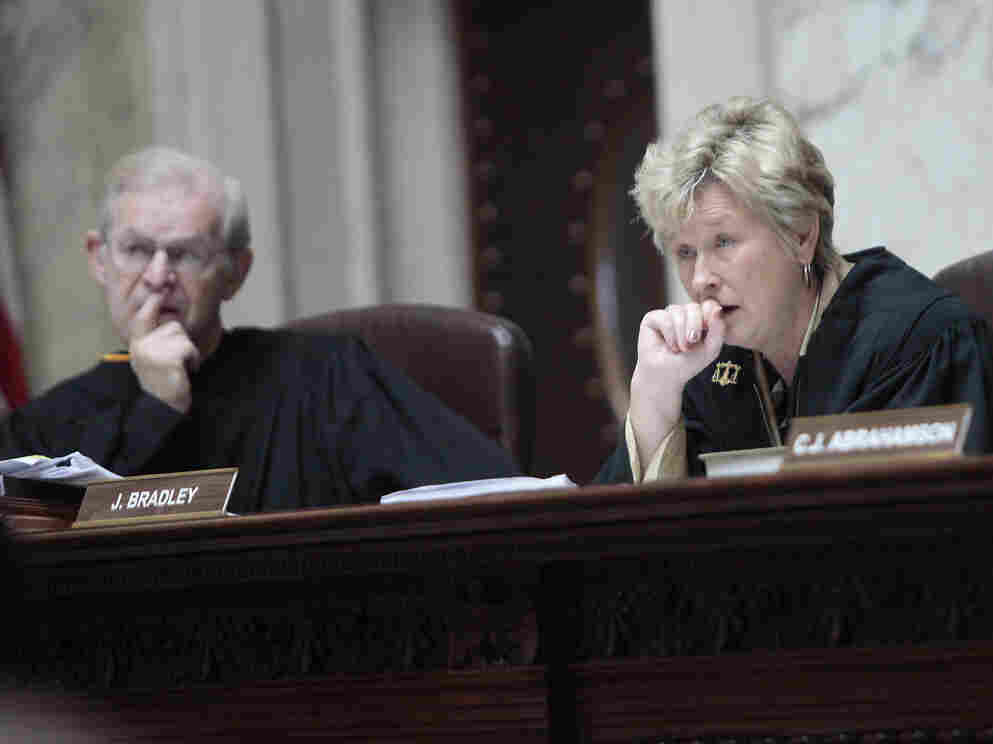 Wisconsin Supreme Court justices David T. Prosser, Jr. and Ann Walsh Bradley, keep their hands to themselves, June 6, 2011.