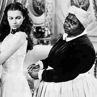 "Labor action: Mammy (Hattie McDaniel, right, with Vivien Leigh's  Scarlett O'Hara) may be devoted to her ""lamb,"" but other accounts of  slave life paint a less cozy picture."