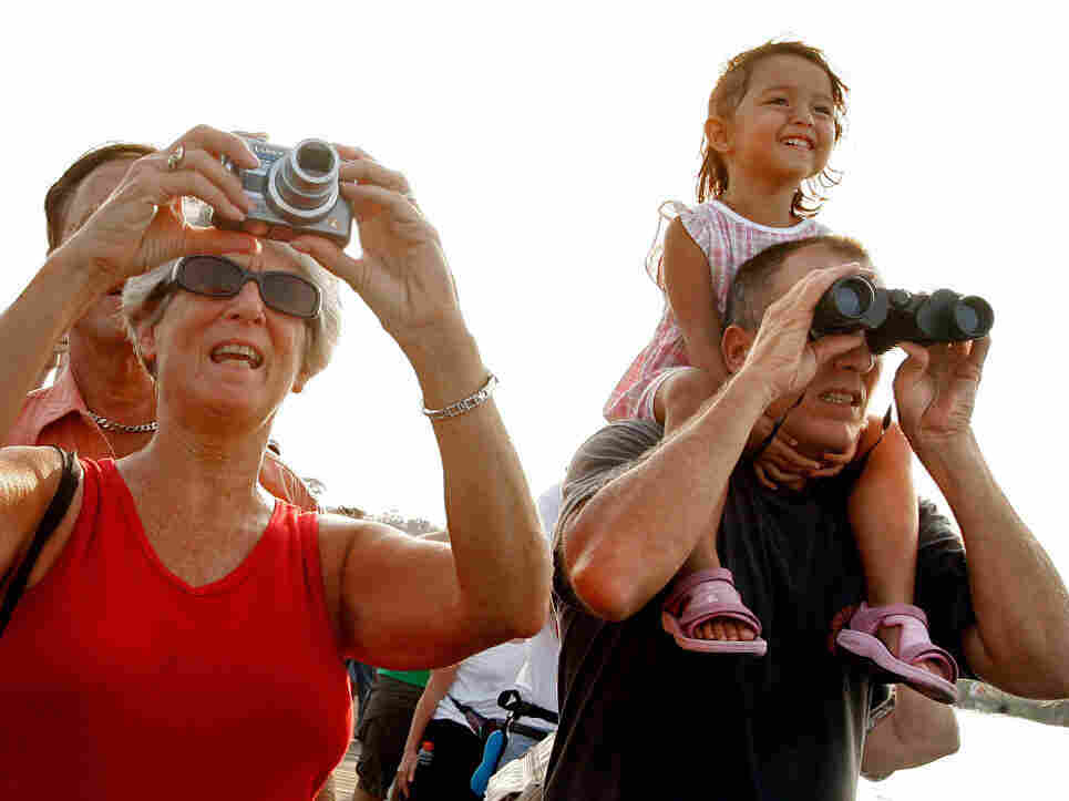 Spectators watch from the Rotary Riverfront Park pier as Space Shuttle  Endeavour launches from Kennedy Space Center Aug. 8, 2007.