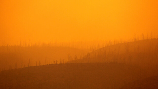 The sun filters through thick smoke from a wildfire burning near Los Alamos, N.M..