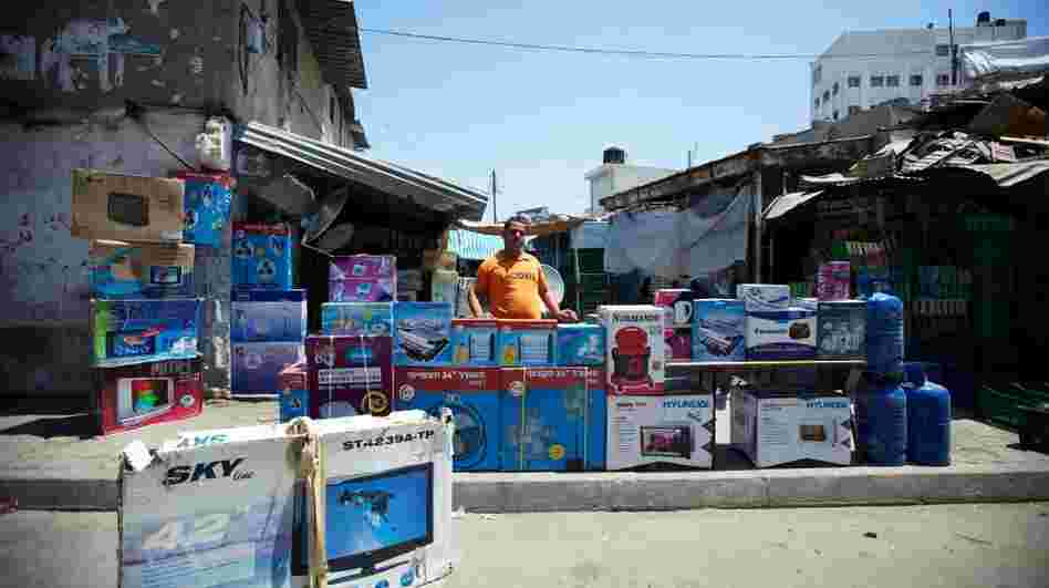 A store owner in a Gaza City market. Israel has eased the blockade of Gaza over the past year, and more commercial goods are reaching the territory.
