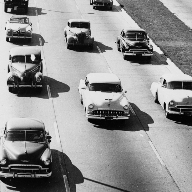 "A highway links Southern California's Ventura and Hollywood freeways in 1953 -- one of the crowning achievements of the ""good roads"" movement that actually began in the 19th century with bicycles."