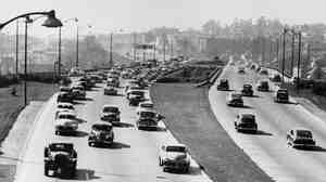 "A highway links Southern California's Ventura and Hollywood freeways in 1953 — one of the crowning achievements of the ""good roads"" movement that actually began in the 19th century with bicycles."