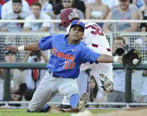 South Carolina's Brady Thomas (36) is safe at first base against Florida first baseman Vickash Ramjit (30) on an RBI-single