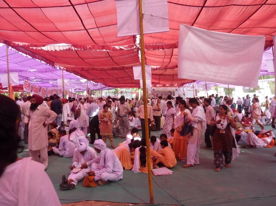 Followers of yoga teacher and anti-corruption activist Baba Ramdev meet in tents.