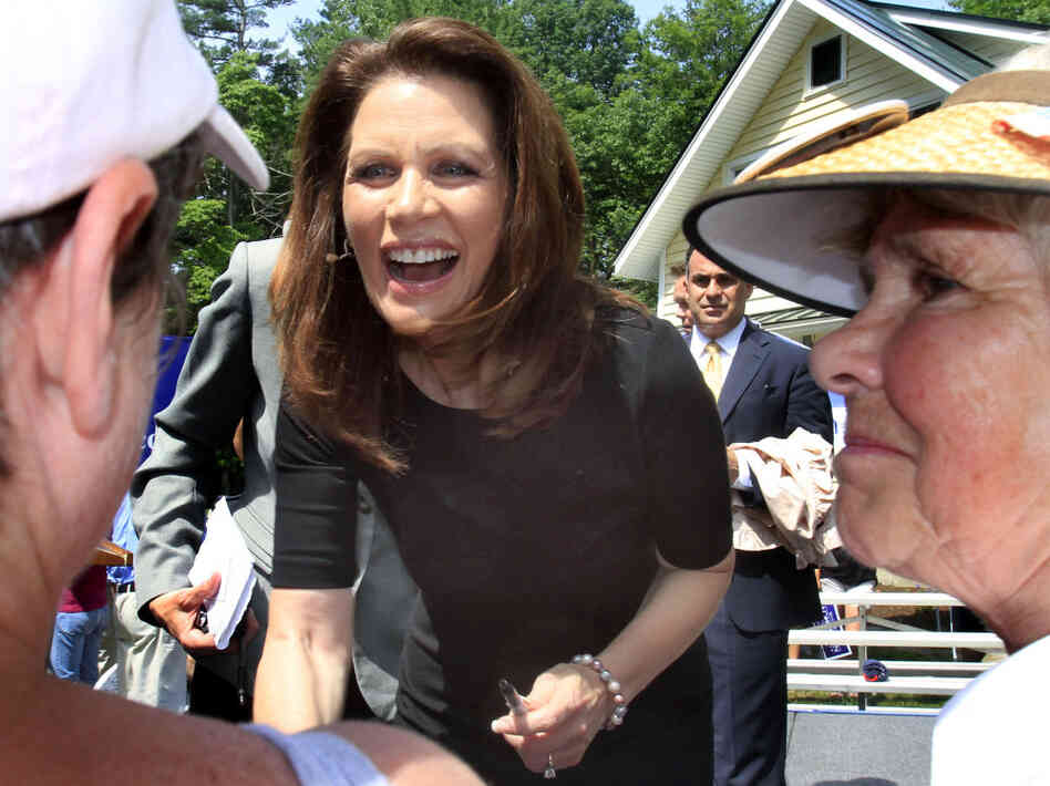 Rep. Michele Bachmann chats with supporters in Raymond, N.H., June 28, 2011.