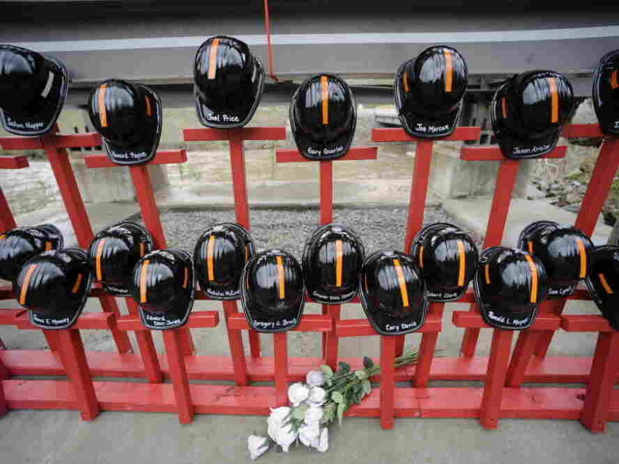 Mine helmets and painted crosses sit at the entrance to  Massey Energy's Upper Big Branch coal  mine on April 5, as a memorial to the 29 miners killed there