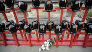 Mine helmets and painted crosses sit at the entrance to  Massey Energy's Upper Big Branch coal  mine on April 5, as a memorial to the 29 mine