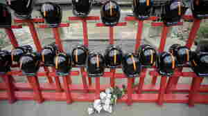 Mine helmets and painted crosses sit at the entrance to  Massey Energy's Upper Big Branch coal  mi