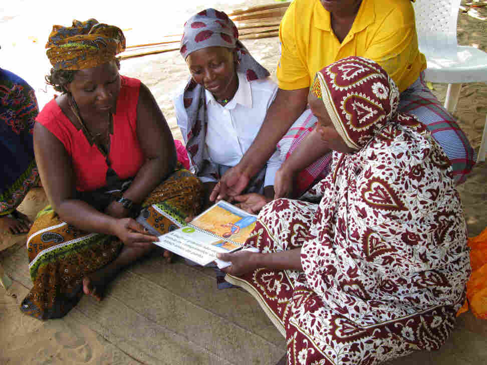 A group of traditional birth attendants took part in a yearlong trial of misoprostol in rural areas of Mozambique. Here they review a booklet on proper administration of the pills.