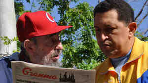 This handout photo released by the Cuban website www.cubadebate.cu shows former Cuban President Fidel Castro and Venezuelan President Hugo Chavez reading Tuesday's edition of the state newspaper Granma in Havana on Tuesday.