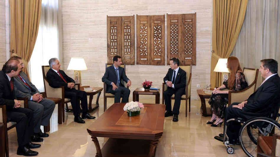 A handout picture released by the Syrian Arab News Agency (SANA) shows Syria's President Bashar al-Assad meeting with U.S. Congressman Dennis Kucinich and his delegation in Damascus.
