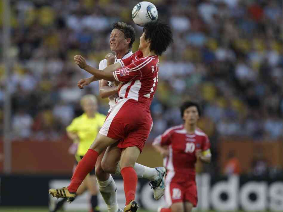 Abby Wambach of the United States battles against North Korea's Ri Un Hyang during the group C match between the United States and North Korea at the Women's