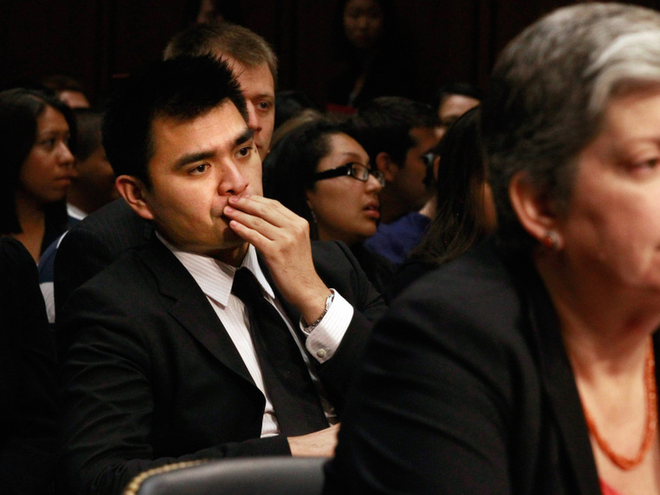 Pulitzer Prize-winning journalist Jose Antonio Vargas sits behind Homeland Security Secretary Janet Napolitano as she testifies before the Senate Judiciary Committee's Subcommittee on Immigration, Refugees and Border Security about the DREAM Act in Washington, DC on Tuesday. Vargas recently went public about being in the country illegally. (Chip Somodevilla/Getty Images)