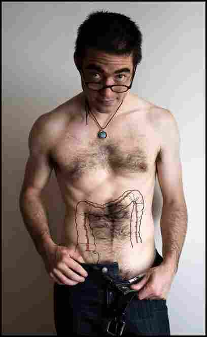 A drawing on Ezra's stomach shows a tattoo he pondered getting after his cancer relapsed and he discovered he would need a colostomy. It prompted our conversations around how the design of medical equipment (specifically, colostomy bags) can affect a patient's dignity and self-esteem.