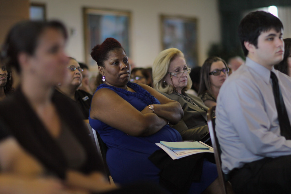 Residents listen during a public hearing on Florida's new Medicaid overhaul, in Miami Gardens, Fla., on June 16.  The overhaul, championed by Gov. Rick Scott as an attempt to save the state money, still needs federal approval.
