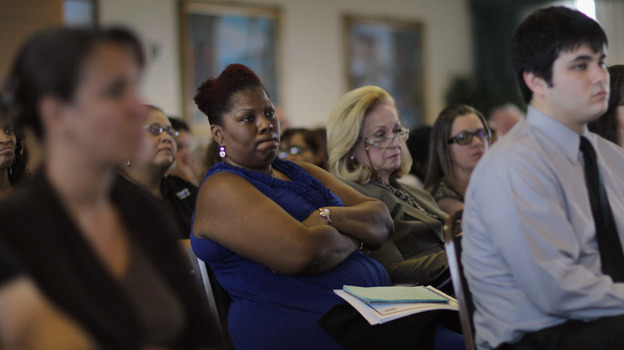 Residents listen during a public hearing on Florida's new Medicaid overhaul, in Miami Gardens, Fla., on June 16.  The overhaul, championed by Gov. Rick Scott as an attempt to save the state money, still needs federal approval. (Getty Images)