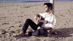 Milos Karadaglich says as soon as he held his father's rusty, old guitar, he knew it was the instrument he would play.