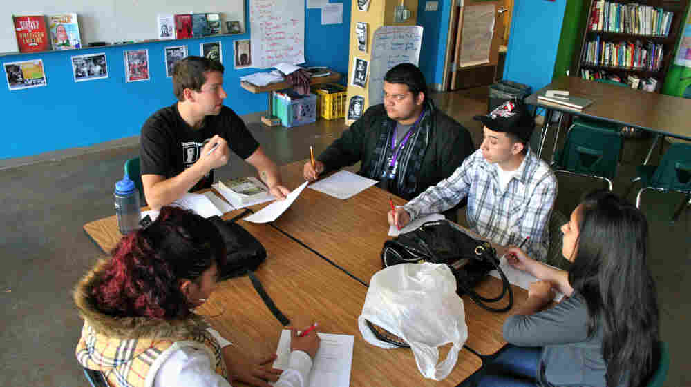 Civics teacher Devin Carberry talks about the bystander effect in relation to the Holocaust with his high school class at the ARISE Charter School in Oakland, Calif.