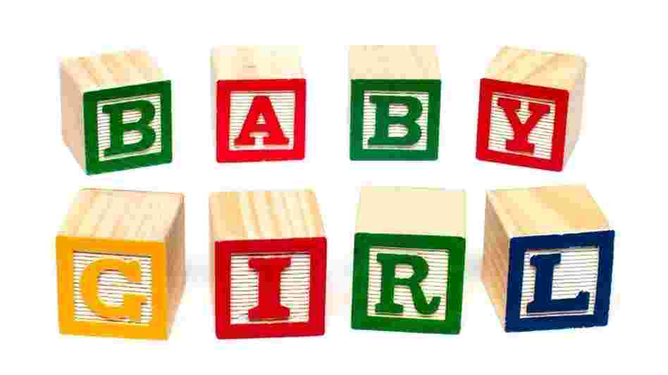 "Blocks that spell out ""baby girl."""