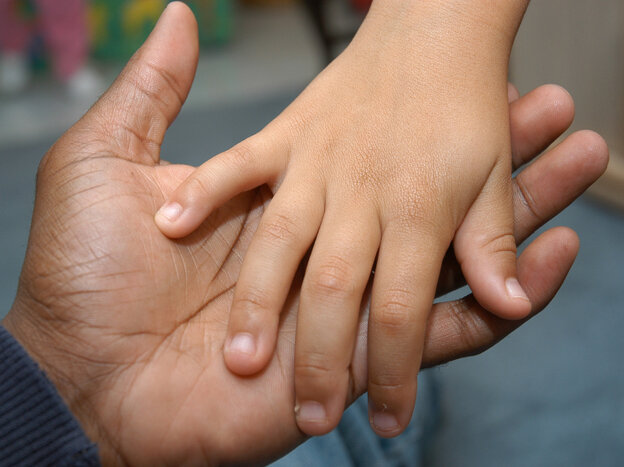 Dads feel stretched thin too. (A father and child hold hands.)