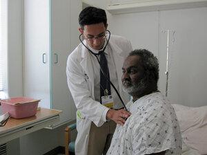Dr. Emil Oweis visits patient Barry Dodson at the Washington Hospital Center in Washington, D.C.