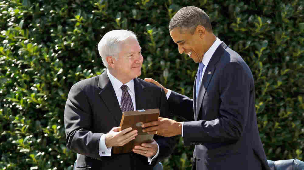 President Obama presents Secretary of Defense Robert Gates with the Presidential Medal of Freedom during a ceremony Thursday on the River Parade Field at the Pentagon.