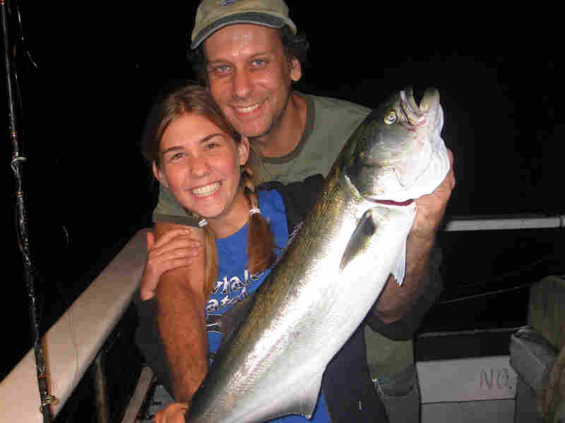 Greenberg and his daughter Tanya fishing