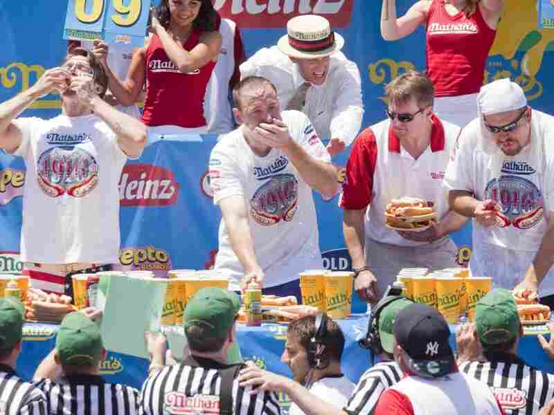 Competitive eaters down their frankfurters in the 2010 Nathan's Famous Fourth of July International Hot Dog Eating Contest at the original Nathan's Famous in Coney Island.