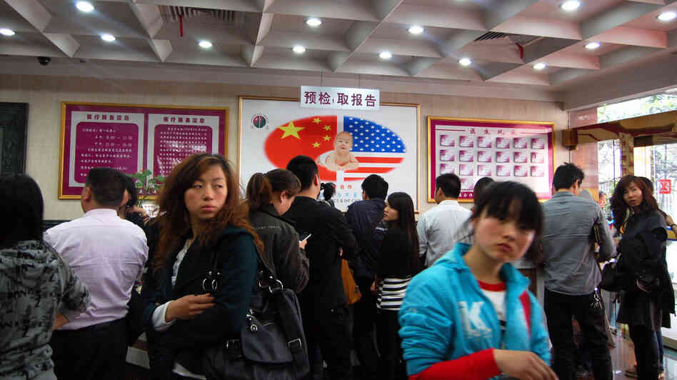 The lobby of the Shanghai Ji Ai Genetics and IVF Institute is filled with clients waiting to see doctors.