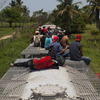 Migrants ride on top of a freight train in the Mexican state of Tabasco.  They'll hop trains for days, possibly even weeks, before getting to the U.S. border.