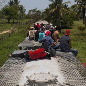 Atop Train Migrants Begin Dangerous Trek To U S