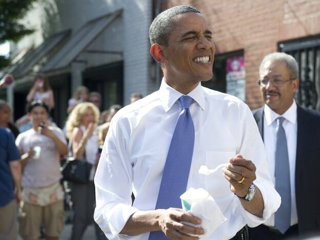President Obama eats an Italian ice during an unannounced stop in Philadelphia where he attended  political fundraisers.