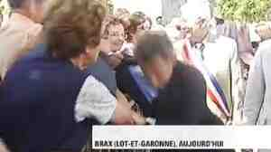 Sarkozy, at center, was pulled toward a barrier and almost knocked over.