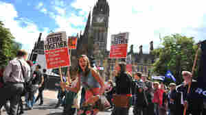 Public sector workers marched through the center of Manchester in northwest England on Thursday during a one-day strike to protest pension cuts.