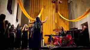 The Assembly of Light Choir performs with doom-metal duo The Body at St. Stephen's church in Washington, D.C.