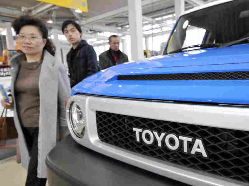 Customers walk past a  Toyota FJ Cruiser. Toyota brought in 19 percent of African-American buyers, 22 percent of Latino buyers and 33 percent of Asian-American buyers.