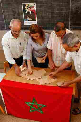 Officials and the president of the polling station count the ballots in a polling station in Rabat.